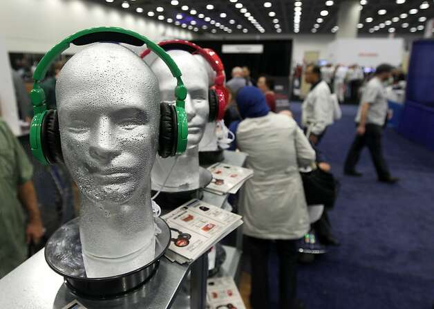 Customized headphones are displayed in the OrigAudio booth at the annual Macworld exhibition in San Francisco, Calif. on Thursday, Jan. 26, 2012. Photo: Paul Chinn, The Chronicle