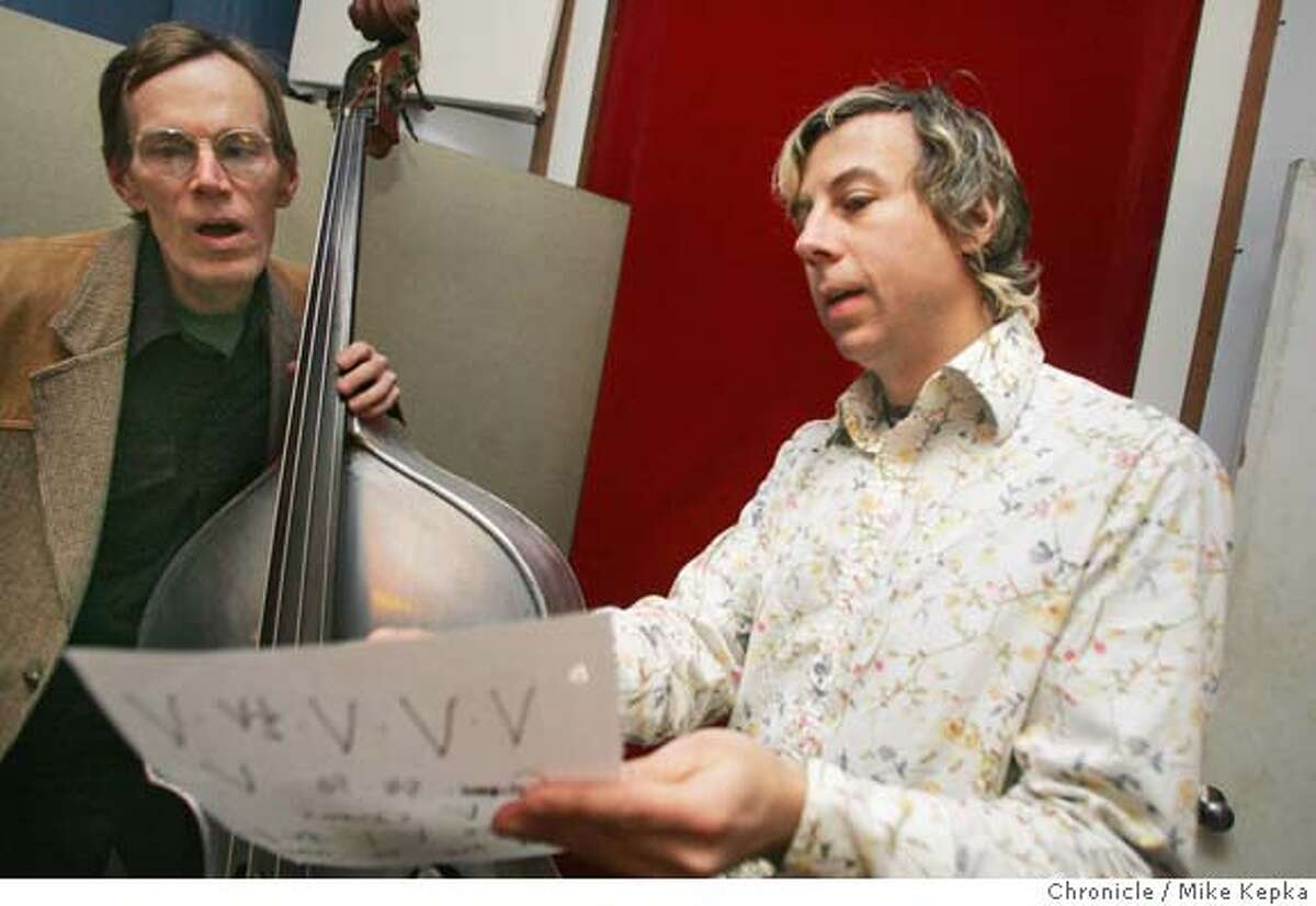 Keith Cary gets direction from John Vanderslice before recording a track at Tiny Telephone. John Vanderslice works on his own record at his studio, Tiny Telephone, in San Francisco. 1/21/05 Mike Kepka/The Chronicle