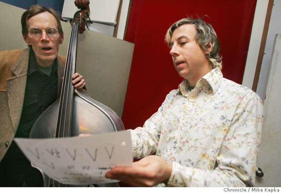 Keith Cary gets direction from John Vanderslice before recording a track at Tiny Telephone.  John Vanderslice works on his own record at his studio, Tiny Telephone, in San Francisco. 1/21/05  Mike Kepka/The Chronicle Photo: Mike Kepka