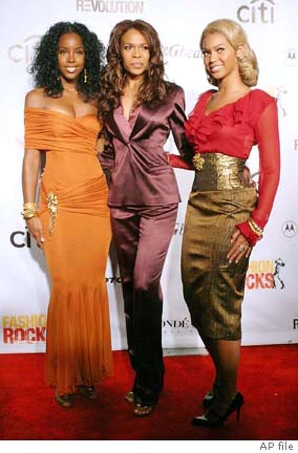 "**FILE** Members of Destiny's Child, from left, Kelly Rowland, Michelle Williams and Beyonce Knowles arrive for the ""Fashion Rocks"" event at New York's Radio City Music Hall in this Sept. 8, 2004, file photo. McDonald's Corp. announced Wednesday, Oct. 6, 2004, that Destiny's Child will play an integral role in its ""I'm lovin' it"" ad campaign, which kicked off last year with Justin Timberlake in a starring role. (AP Photo/Tina Fineberg, File) Ran on: 10-08-2004  Mick Jagger, accompanied by Dave Stewart, sings for the &quo;Alfie&quo; soundtrack at Abbey Road studios in London. Photo: TINA FINEBERG"