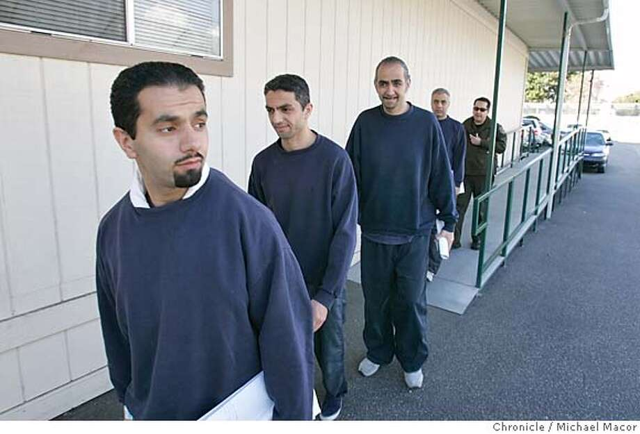iranian_179_mac.jpg l to r- Mohammed, Mohsen and Mojtaba and Mostafa Mirmehdi, are taken back to the detention facility. Meeting with the Mirmehdi brothers, who are being held at the San Pedro Federal Processing Center by Homeland Security. The four brothers are accused of being Mujahedin Khalq members who have been jailed for almost four years. 1/6/05 Los Angeles, Ca Michael Macor / San Francisco Chronicle Mandatory Credit for Photographer and San Francisco Chronicle/ - Magazine Out Photo: Michael Macor