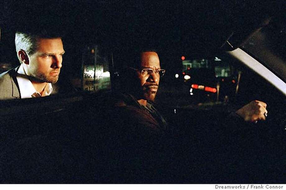 "A Los Angeles cab driver Max (Jamie Foxx) is stunned to learn that his latest fare, Vincent (Tom Cruise) is a contract killer who has hijacked his cab to complete five hits in one night, in ""Collateral."" (Dreamworks / Frank Connor) Ran on: 08-08-2004  Michael Mann on the &quo;Collateral&quo; set with Tom Cruise and Jamie Foxx. Photo: FRANK CONNOR"