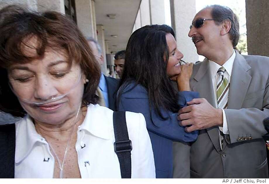 Mark Geragos, attorney for Scott Peterson, right, is greeted by crime book author Aphrodite Jones as he leaves the San Mateo Superior County Court with Jackie Peterson, the mother of Scott Peterson, left, in Redwood City, Calif., on Thursday, Aug. 5, 2004. Scott Peterson is the Modesto, Calif., man who could face the death penalty if he's convicted of two counts of murder for the deaths of his wife, , and their unborn son. (AP Photo/Jeff Chiu) Photo: JEFF CHIU