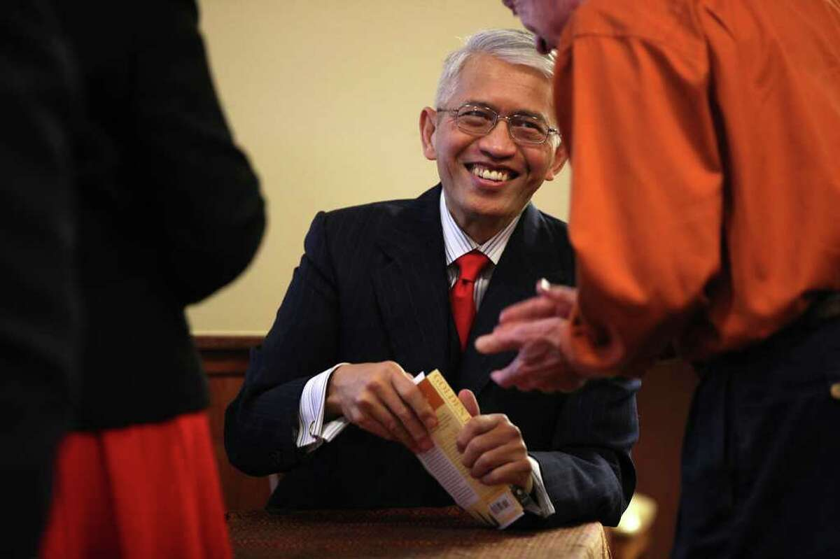 """Former U.S. Ambassador to the United Nations Sichan Siv signs copies of his book, """"Golden Bones,"""" after speaking at an Optimist Club Luncheon. Siv is a survivor of the Khmer Rouge Killing Fields and is now residing in San Antonio."""