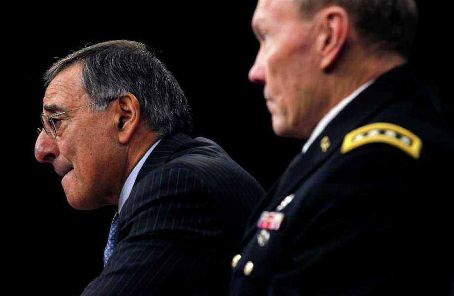 Sec. of Defense Leon Panetta, left, and Chairman of the Joint Chiefs of Staff Gen. Martin E. Dempsey, right, outline the main areas of proposed spending cuts during a news conference at the Pentagon in Washington, Thursday, Jan., 26, 2012. Photo: Pablo Martinez Monsivais, AP / Azon Chan