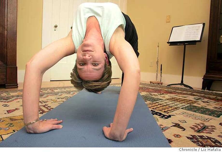 MTT_LH_097jpeg.JPG Cathy Payne, the SF Symhony's piccolo player, at home doing yoga in advance of her first big solo turn. Shot in San Francisco on 1/14/05.PAYNE_LH_097jpeg.JPG Cathy Payne, the SF Symhony's piccolo player, at home in advance of her first big solo turn. Shot in San Francisco on 1/14/05. Creditted to San Francisco Chronicle/ Photo: Liz Hafalia