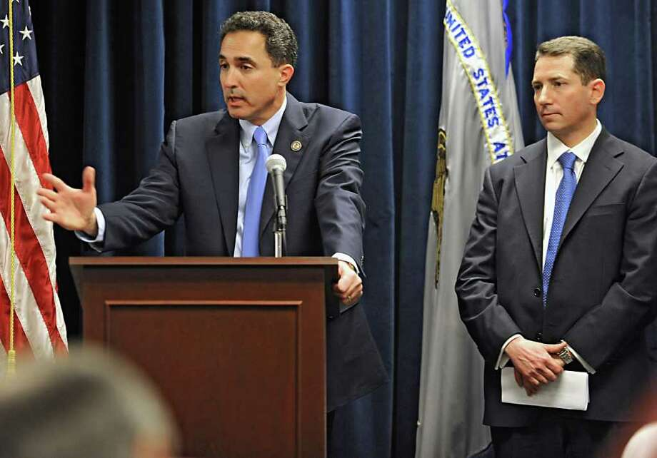 U.S. Attorney Richard Hartunian announces the indictment of Timothy McGinn and David Smith  Thursday Jan 26, 2012 at the U.S. District Courthouse in Albany, N.Y. McGinn and Smith are accused by the SEC of defrauding 900 investors of $136 million. Victor Lessoff, Acting Special Agent-in-Charge, IRS, Criminal Investigation, NY Field Office, stands on the right. (Lori Van Buren / Times Union) Photo: Lori Van Buren