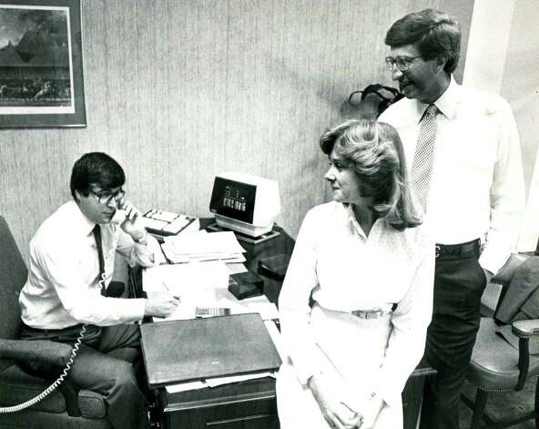 Tim McGinn, left, Marianne Goodman, center, and David Smith, right, at the McGinn Smith office September 1, 1981. (Times Union archive)
