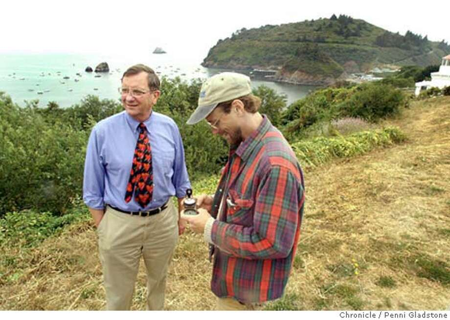 Dean Heyenga, Mayor of Trinidad talks with Scott Willits, a Thermographer from Arcata. Scott takes a compass reading of where the device will be. (Behind them is Trinadad Head) City of trinidad will be putting a device in the ocean that uses wave action to pump seawater to a reservoir, which is then released down a flume and spins a turbine. generating as much juice as a nuclear plant. 7/13/04 in Trinadad.  Penni Gladstone / The Chronicle Photo: Penni Gladstone