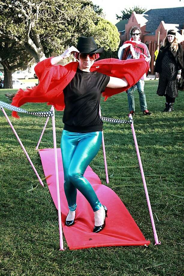 """Love me, Love my Poncho"" fashion show organizer Mirabelle Jones wears her ""red poncho of justice"" on the red carpet at Delores Park on Sunday January 15, 2012. Photo: Aura O'Brien"