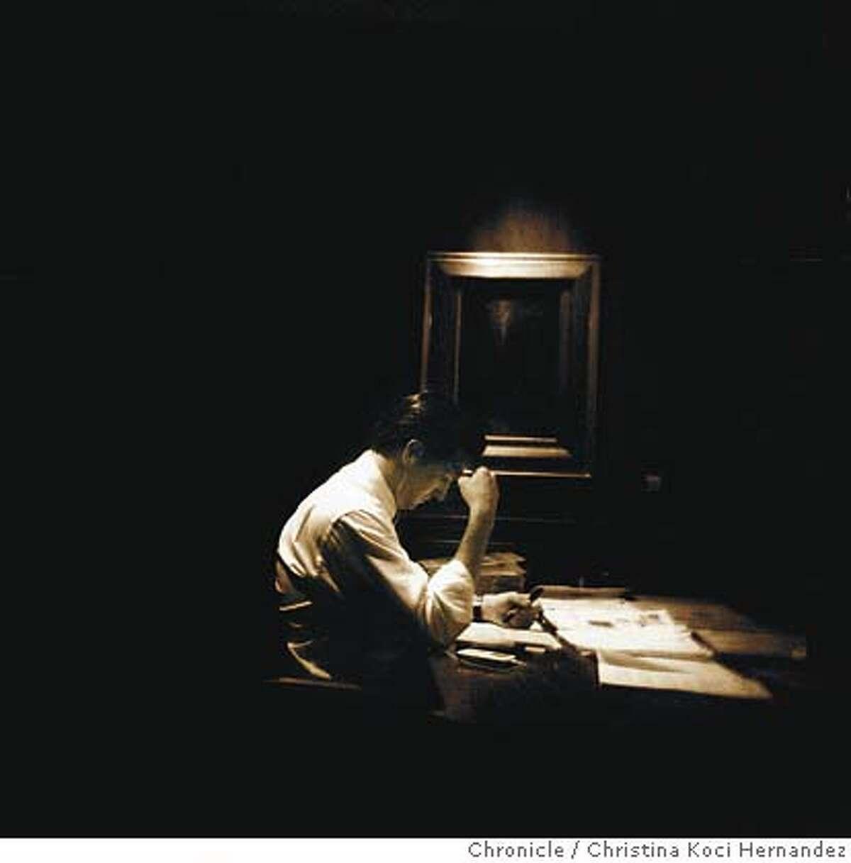 Mayor Gavin Newsom works at his desk at City Hall. Chronicle photo by Christina Koci Hernandez