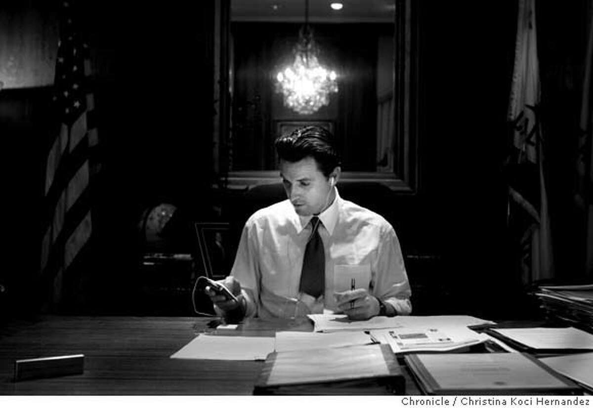 Mayor Gavin Newsom listen to his IPOD during some downtime, in his office. .CHRISTINA KOCI HERNANDEZ/CHRONICLE