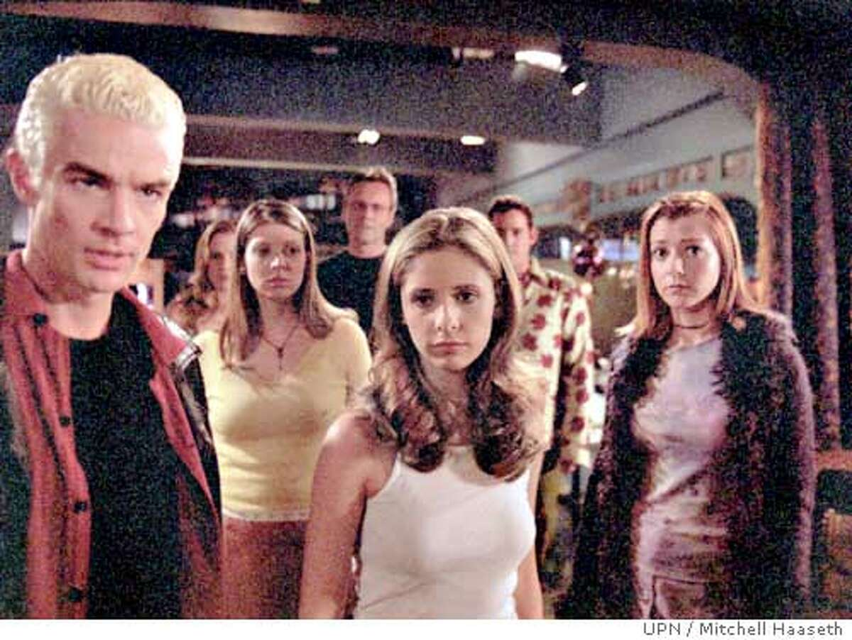 """GOODMAN03A-C-31MAY02-DD-UPN --- """"Once more with Feeling"""" James Marsters, Emma Caulfield, Amber Benson, Anthony Stewart Head, Sarah Michelle Gellar, Nicholas Brendon, Alyson Hannigan in BUFFY THE VAMPIRE SLAYER on UPN. Photo: Mitchell Haaseth/�UPN2001 (HANDOUT PHOTO) ALSO RAN 01/14/03, 05/19/03 Ran on: 08-03-2004 Heroines of the day: Buffy the Vampire Slayer (Sarah Michelle Gellar, center, left), Lara Croft (Angelina Jolie, below) and Xena (Lucy Lawless, below, left)."""