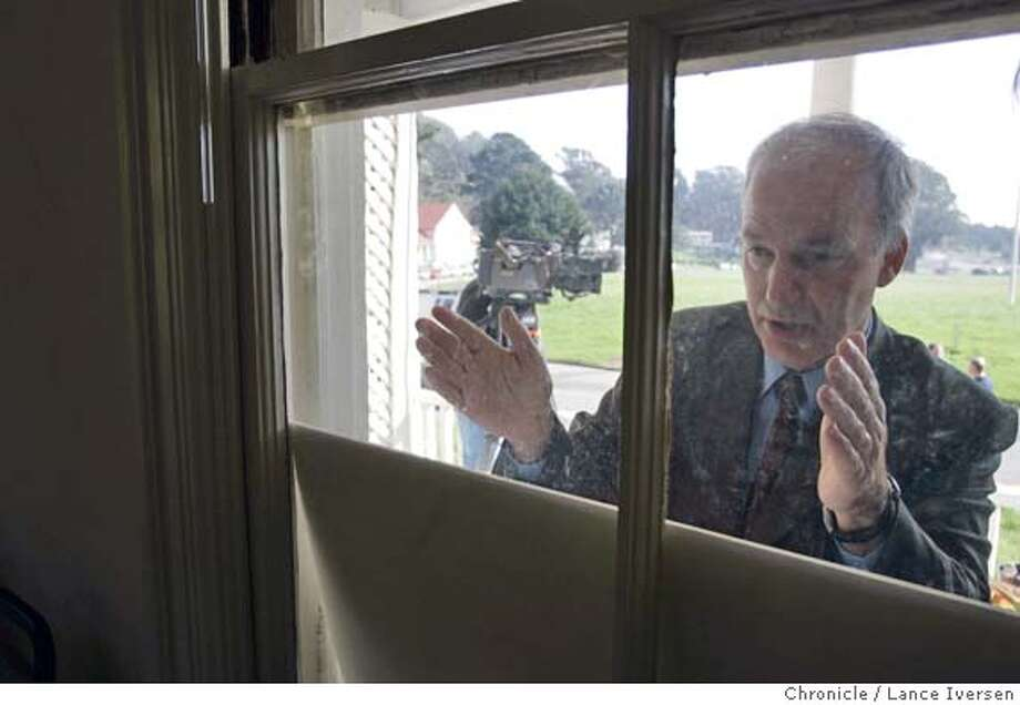 FORTBAKER20_043.jpg_  Tom Sargent President of Fort Baker Retreat Group peeks through a window of the Commanders House to describe to the media what he hopes to accomplish after a press conference was held Wed at Fort Baker that announced an agreement between the City of Sausalito and National Park Service over the future use of the former Civil War-era Army base at the north end of the Golden Gate Bridge. By Lance Iversen/San Francisco Chronicle MANDATORY CREDIT PHOTOG AND SAN FRANCISCO CHRONICLE. Photo: Lance Iversen