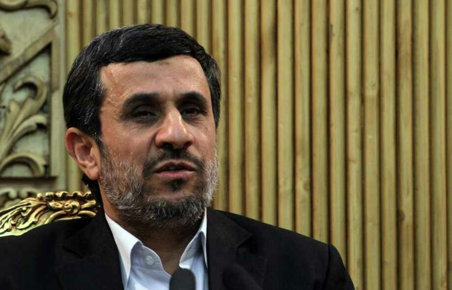Iranian President Mahmoud Ahmadinejad speaks to the press prior upon his arrival at Tehran's Mehrabad Airport on January 14, 2012 after a five-day visit to Venezuela, Nicaragua, Cuba and Ecuador.      AFP PHOTO/ATTA KENARE (Photo credit should read ATTA KENARE/AFP/Getty Images) Photo: ATTA KENARE / AFP