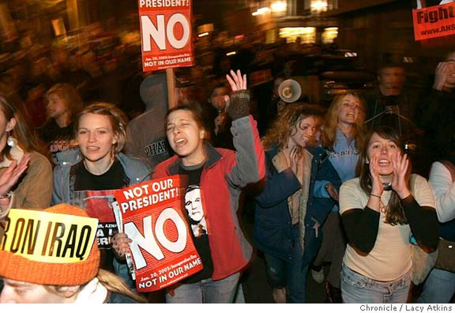 "(left to right) Kathryn Robinson and friend Julia Marino chant"" Not our President"" as they march with the hundreds from San Francisco City Hall to Justin Herman Plaza in protest of the inauguration,Thursday Jan. 20,2005. of Hundreds of people from the Bay Area gather at San Francisco City Hall to protest George Bush's Inauguration, Thursday Jan.20, 2005.  LACY ATKINS/SAN FRANCISCO CHRONICLE Photo: LACY ATKINS"