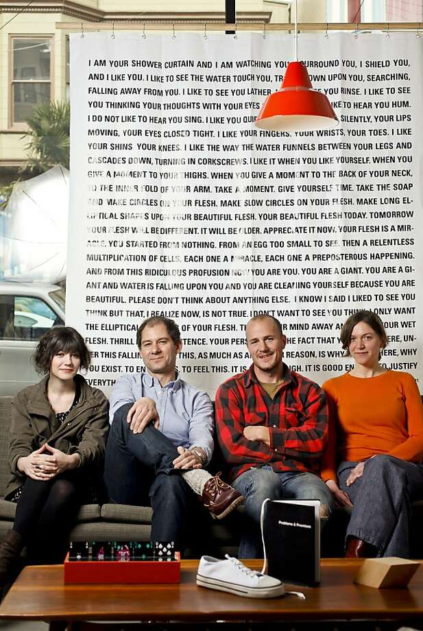 "Assistant editor Caitlin Kirkpatrick, Editors Jonn Herschend and Will Rogan, and intern Genessa Keahola of, ""The Thing Quarterly,"" are seen in their Mission District office on Wednesday, Jan. 18, 2012 in front of Dave Eggers' issue 16 shower curtain. Photo: Russell Yip, The Chronicle"