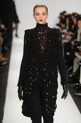 A model walks the runway in a crystal-studded knitwear design by Sabah Mansoor Husain at the Academy of Art University Fall 2010 fashion show in New York City. Photo: Frazer Harrison