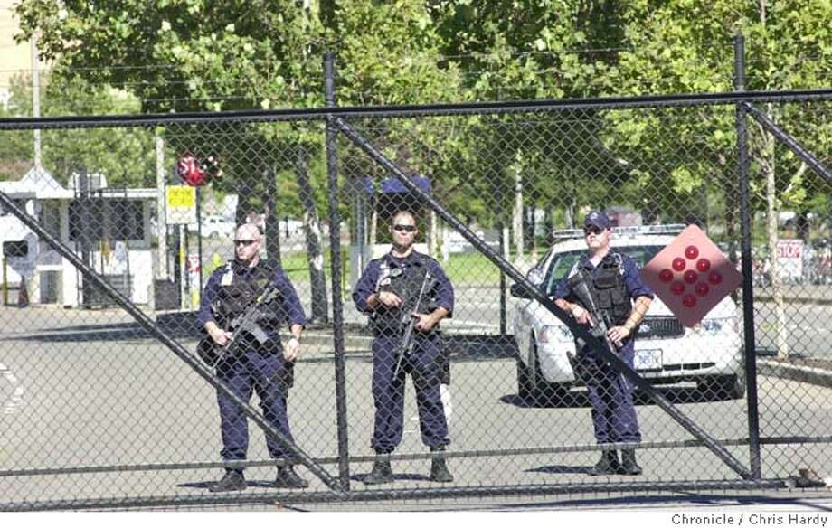 Lab cops at West gate.  Rally at Livermore Lab to protest nuclear weapons on the anniversary of Nagasaki bombing  8/10/03 in Livermore. CHRIS HARDY / The Chronicle Photo: CHRIS HARDY