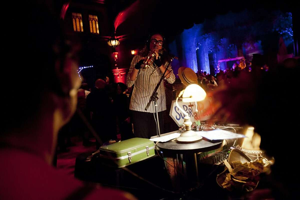 Musician SuperTall Paul Newman plays an instrument during at the annual Edwardian Ball at the Regency Ballroom in San Francisco, Calif. on Saturday, Jan. 21, 2012. Now in its twelfth year, the ball features a variety of themed theatre, music, circus, and dancing of the Edwardian era.