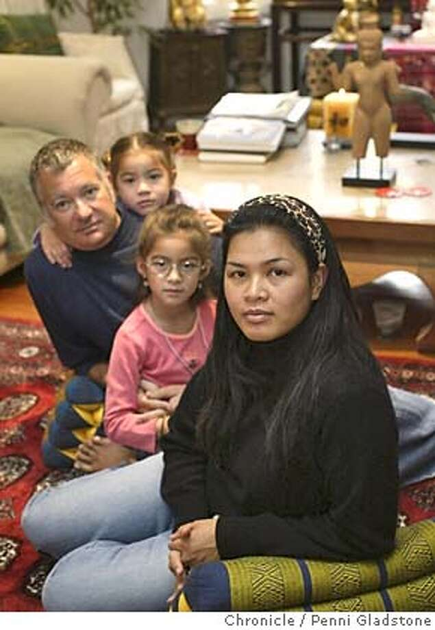 tsunami14whitney014PG.JPG  Skip, his wife Aew Whitney and their kids Aisha age 6 in pink in front and Adara age 4. Whitney, a local real estate developer, and his family at home. The Whitney's traveled to South Asia for the holidays and were there when the tsunami hit the region. While unharmed themselves, they saw first-hand the destruction that ravaged Sri Lanka.  The San Francisco Chronicle, Penni Gladstone  Photo taken on 1/13/05, in Mill Valley, Photo: Penni Gladstone