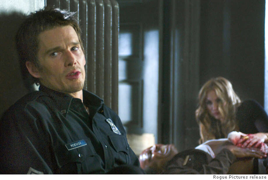 ASSUALT19 Ethan Hawke (left), Dorian Harewood (center) and Drea De Matteo (right) star in Jean-Francois Richet�s ASSAULT ON PRECINCT 13, a Rogue Pictures release