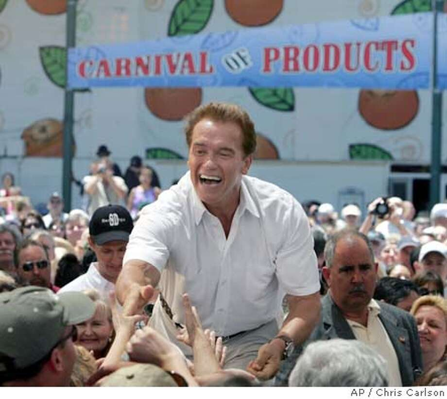 California Gov. Arnold Schwarzenegger thanks supporters for pressing legislators to pass the state budget Friday, July 30, 2004, during a visit to the Orange County Fair in Costa Mesa, Calif. (AP Photo/Chris Carlson) Photo: CHRIS CARLSON
