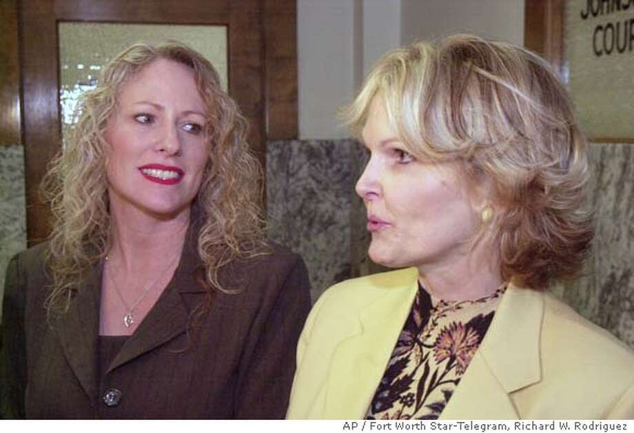 Joanne Webb, left, looks on as her atorney BeAnn Sisemore addresses the media Monday Dec. 15, 2003, at the Johnson County Courthouse in Cleburne, Texas, after a hearing. Webb intended to spice up marriages and earn extra cash by selling erotic toys as one of Passion Parties Inc.'s 3,000 national consultants. Instead, the former fifth-grade teacher and executive board member of the Burleson Chamber of Commerce faces criminal charges and embarrassment after a police sting. Webb made her first court appearance Monday. Judge Robert Mayfield approved a pretrial hearing but did not set a date. (AP Photo/Fort Worth Star-Telegram, Richard W. Rodriguez) Joanne Webb (left) looks on as her attorney, BeAnn Sisemore, talks to reporters at the Johnson County Courthouse in Cleburne, Texas, after a hearing on obscenity charges filed against Webb. DALLAS OUT, MAGS OUT, Photo: RICHARD W. RODRIGUEZ