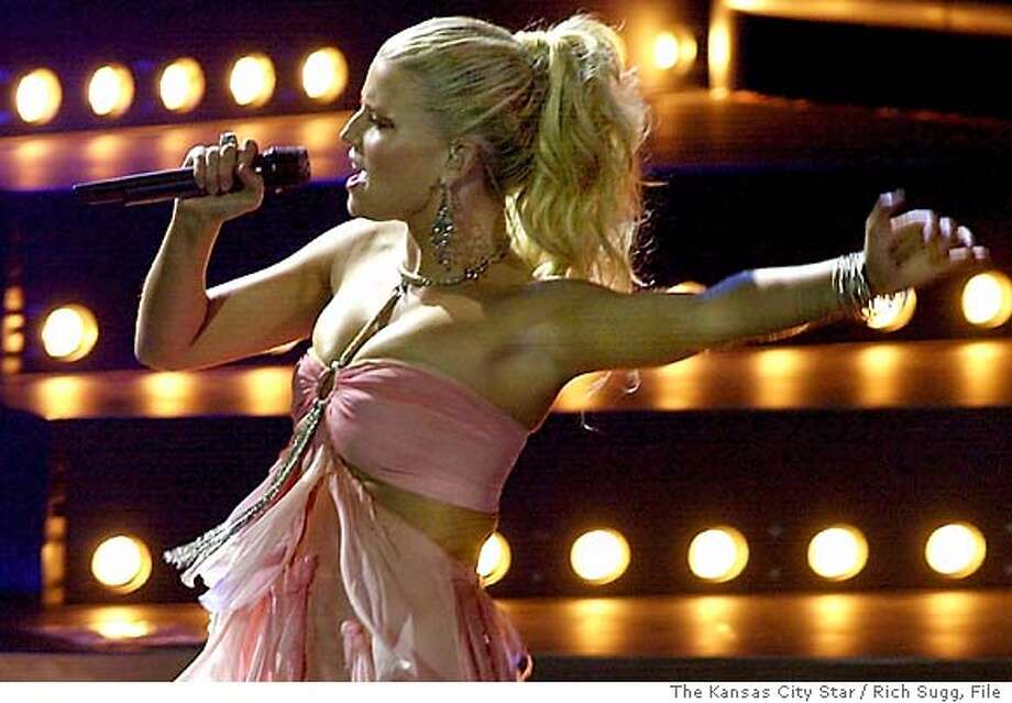 Teen idol Jessica Simpson was in Kansas City, Mo., Thursday night, July 8, 2004, for a performance at Verizon Amphitheater in Bonner Springs, Kan. Pausing after her second song, Simpson had this to say about the heat and humidity - ``I guess we can all bathe in our sweat.'' (AP Photo/The Kansas City Star / Rich Sugg) Photo: Rich Sugg