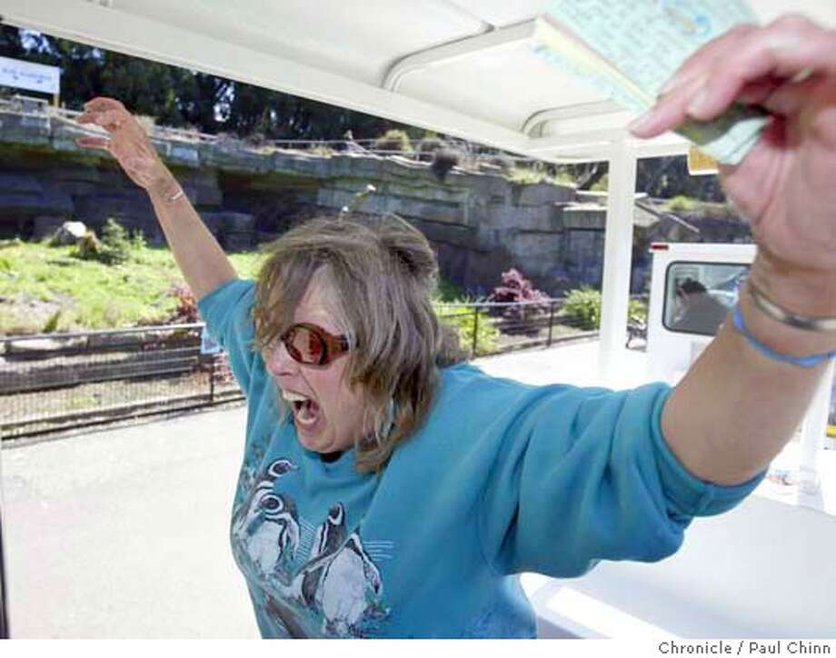 Jane Tollini told an animated story about a former bear resident in front of the bear grotto. Zookeeper Jane Tollini leads a tram tour of the SF Zoo to mark its 75th anniversary in San Francisco on 7/28/04. PAUL CHINN/The Chronicle Photo: PAUL CHINN