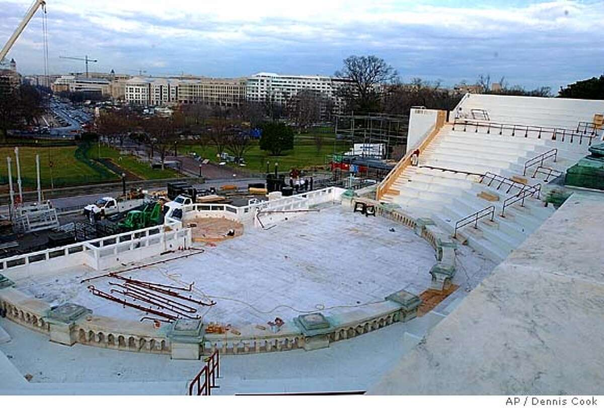 Work continues on Capitol Hill, Tuesday, Jan. 4, 2005 on the area for President Bush's inauguration. The president will take his oath on Jan. 20. (AP Photo/Dennis Cook)