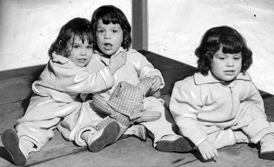 The Toupes triplets (from left) Carol Anne, Barbara Maude, and Beverly Cecile in 1938.