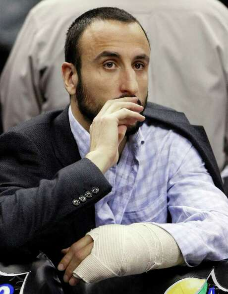 The Spurs have gone 9-5 since guard Manu Ginobili went down with a broken left hand. Photo: AP