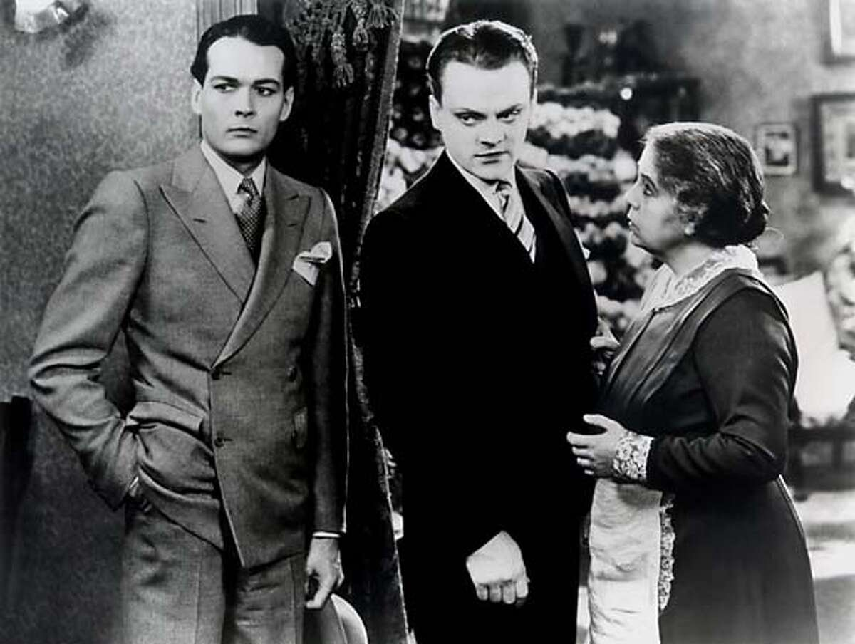 """still from """"The Public Enemy,"""" left to right: unknown actor, James Cagney, Beryl Mercer (who plays the cagney characters mother)"""