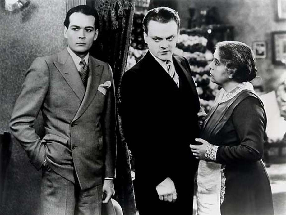 "still from ""The Public Enemy,"" left to right: unknown actor, James Cagney, Beryl Mercer (who plays the cagney characters mother)"