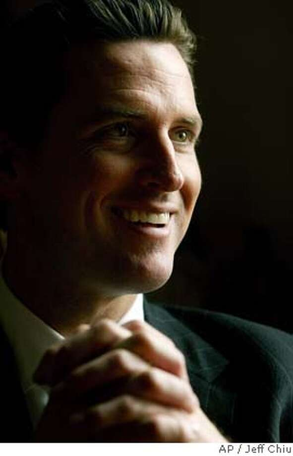 ** FILE ** San Francisco Mayor Gavin Newsom smiles during an interview at City Hall in San Francisco in this Feb. 21, 2004, file photo. The Senate handed President Bush and his most conservative backers an embarrassing setback Wednesday by voting to block a constitutional amendment that would have banned same-sex marriage. Newsom said that after absorbing months of criticism for helping make gay marriage an election year issue, he was more than happy to claim a little credit for making Bush look bad. (AP Photo/Jeff Chiu, File) FEB. 21, 2004, FILE PHOTO. Photo: JEFF CHIU