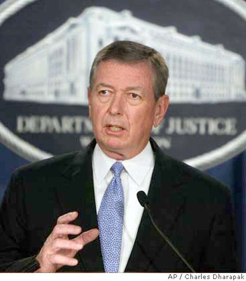 Attorney General John Ashcroft speaks at a news conference announcing the indictment against the Holy Land Foundation for Relief and Development Tuesday, July 27, 2004, in Washington. A major American Muslim charity and seven of its officers were charged Tuesday with providing millions of dollars in support to Hamas, a Palestinian terrorist organization blamed for dozens of suicide bomber attacks in Israel. (AP Photo/Charles Dharapak) Photo: CHARLES DHARAPAK