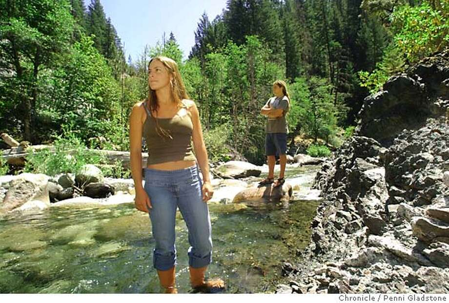 Katlin and Michael Curran stand in beautiful Canyon Creek below the areas to be mined.  7/12/04 in Junction City.  Penni Gladstone / The Chronicle Photo: Penni Gladstone