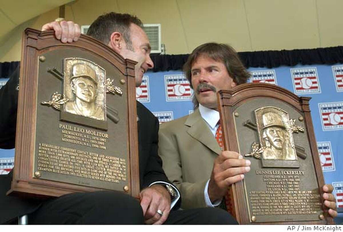 New Baseball Hall of Fame inductees Paul Molitor, left, and Dennis Eckersley hold their plaques after induction ceremonies on Sunday, July 25, 2004, in Cooperstown, N.Y. (AP Photo/Jim McKnight)