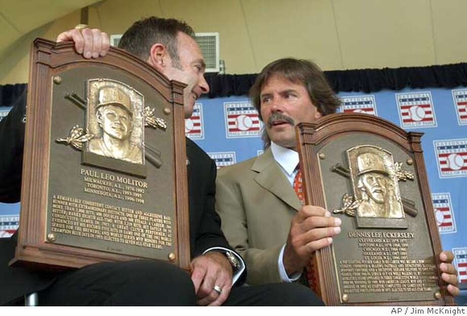 New Baseball Hall of Fame inductees Paul Molitor, left, and Dennis Eckersley hold their plaques after induction ceremonies on Sunday, July 25, 2004, in Cooperstown, N.Y. (AP Photo/Jim McKnight) Photo: JIM MCKNIGHT