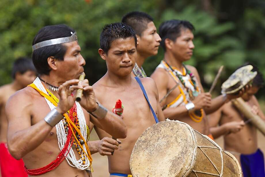 Embera Indians perform a traditional dance for tourist and visitors  at the Embera Drua Reservation on the Chagres River in Panama, Friday, November 18, 2011. (AP Images/Tito Herrera) Photo: Tito Herrera, Associated Press