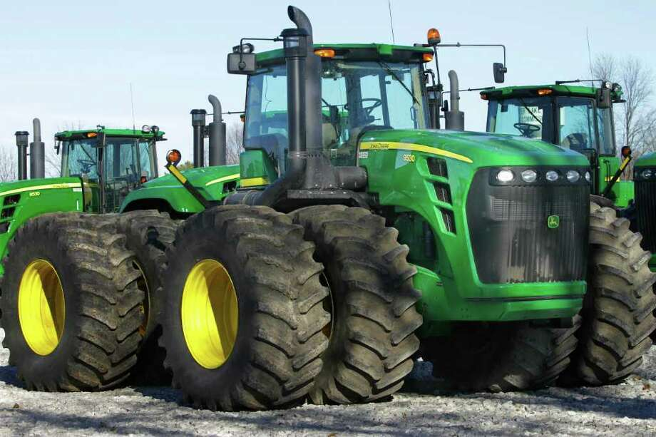 JIn this Jan. 6, 2012 photo, John Deere farm tractors are displayed at Sloan's Implement John Deere Dealership, in Virden, Ill. Orders to U.S. factories for long-lasting manufactured goods increased in December after business stepped up spending on machinery and other capital goods. (AP Photo/Seth Perlman) Photo: Seth Perlman