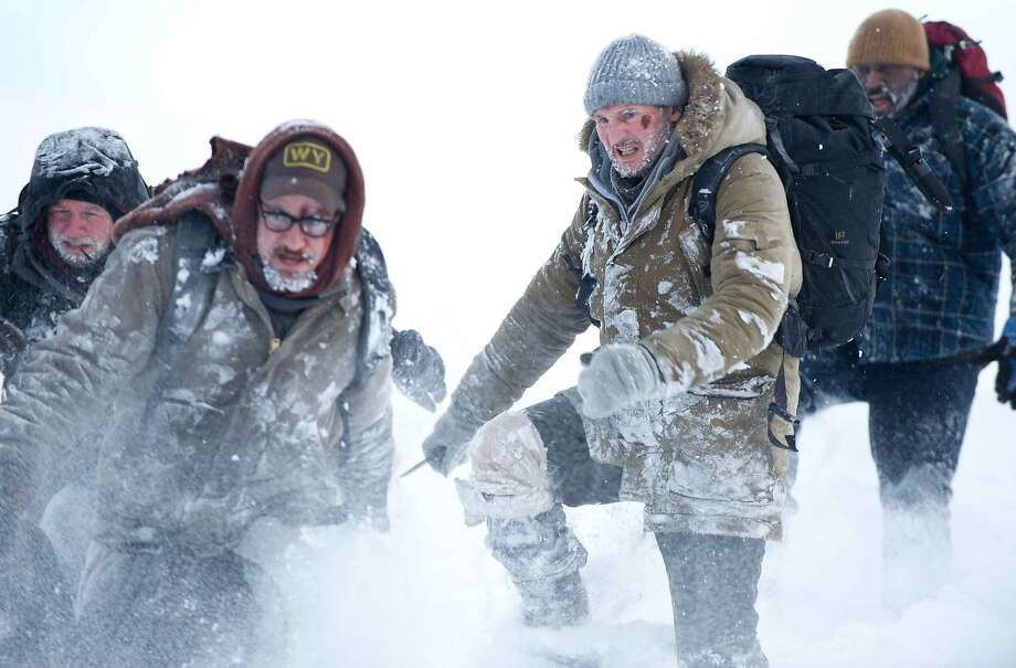 Dallas Roberts (left), Dermot Mulroney, Liam Neeson and Nonso Anozie are stranded in Alaska. Photo: Kimberly French, Open Road Films