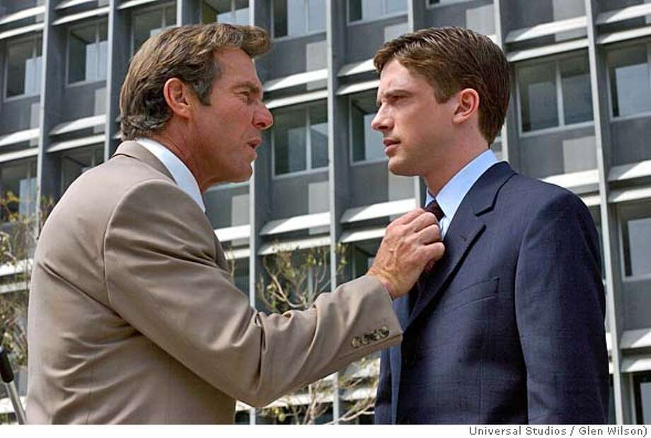 "In this photo provided by Universal Studios, Dan Foreman (Dennis Quaid, left) and his boss, Carter Duryea (Topher Grace) , in the comedy "" In Good Company."" (Universal Studios/ Glen Wilson) Ran on: 01-09-2005  Dennis Quaid and Topher Grace are uneasy colleagues in &quo;In Good Company.&quo; Photo: GLEN WILSON"