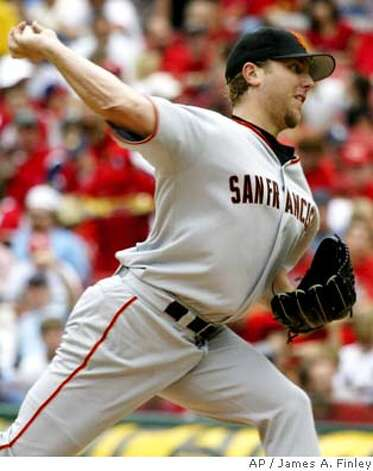 San Francisco Giants starting pitcher Brett Tomko pitches during the third inning against the St. Louis Cardinals in St. Louis Saturday, July 24, 2004. Tomko pitched eight innings and allowed two runs on six hits. The Cardinals defeated the Giants by the final score of 5-3. (AP Photo/James A. Finley) Photo: JAMES A. FINLEY