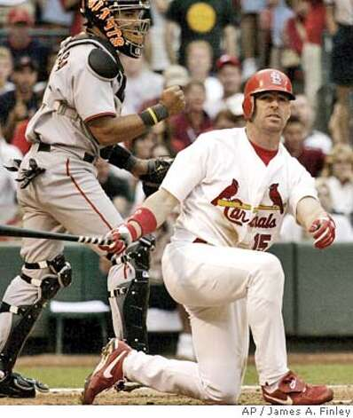 St. Louis Cadrinals Jim Edmonds falls to one knee after striking out in the eleventh inning with San Francisco Giants catcher Yorvit Torrealba at the plate in St. Louis Saturday, July 24, 2004. The Giants defeated the Cardinals by the final score of 5-3.(AP Photo/James A. Finley) Photo: JAMES A. FINLEY
