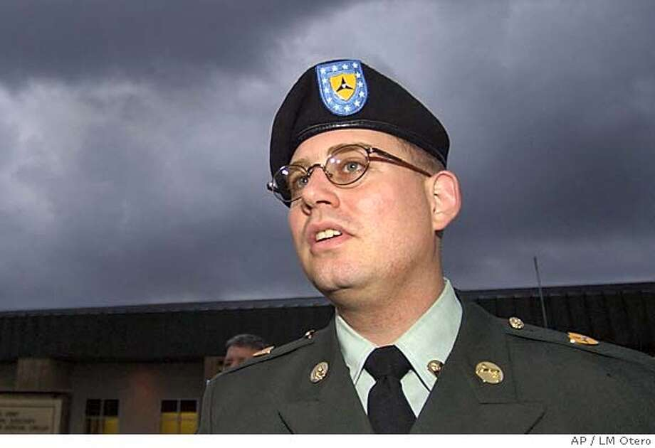 Army Spc. Charles Graner leaves the judicial complex after day four of his court-martial at Fort Hood, Texas, Wednesday, Jan. 12, 2005. Graner is the accused ringleader in the Abu Ghraib scandal. (AP Photo/LM Otero) Photo: LM OTERO