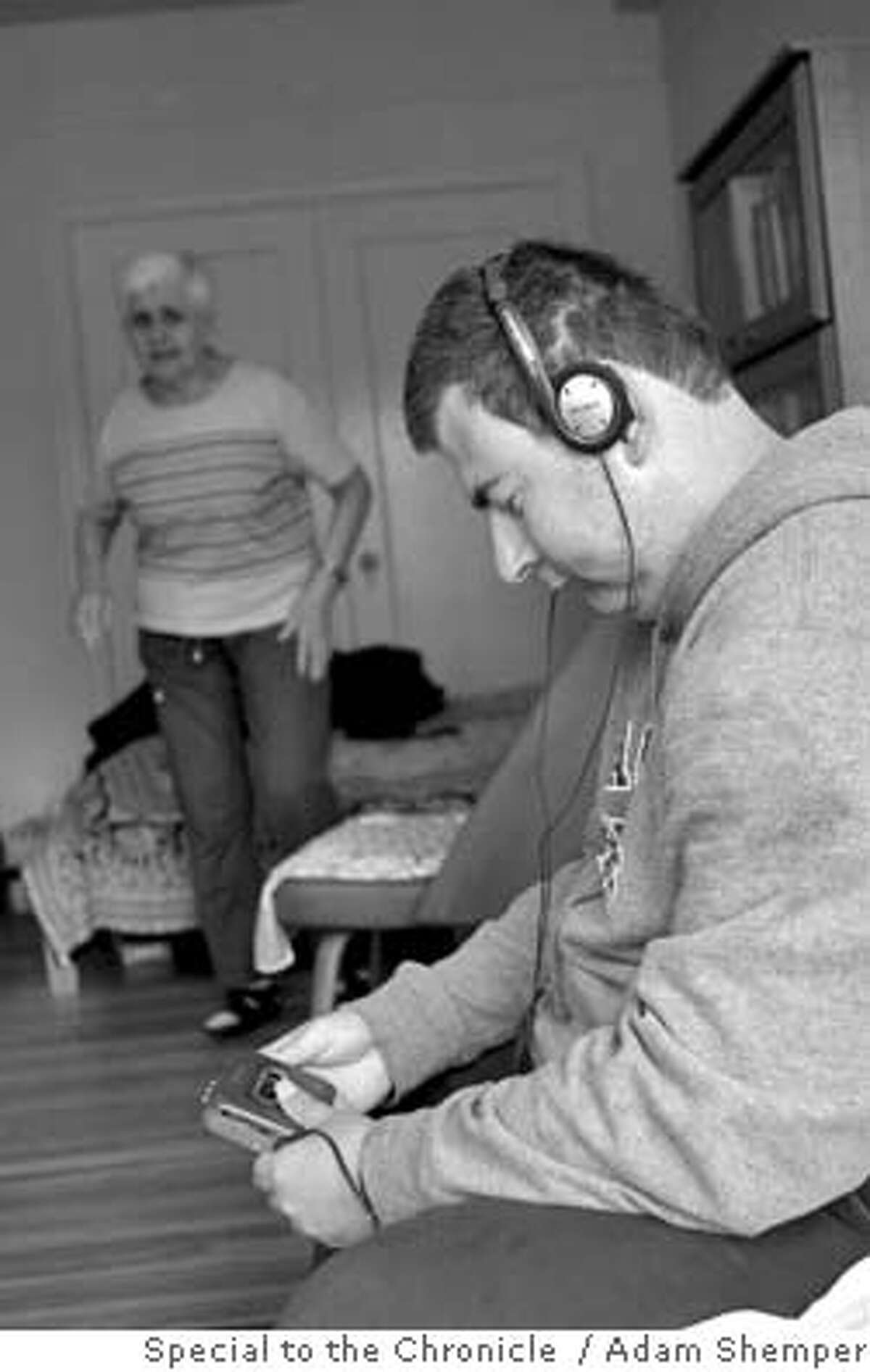 Stan listens to Madonna on his headphones at his mother's apartment. On the weekends he visits his mother, Inga, who lives in a studio apartment in the Richmond district in San Francisco.