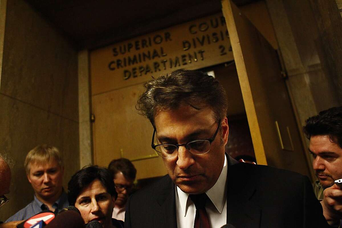 Sheriff Ross Mirkarimi (front) leaves Department 24 at the Hall of Justice with attorney Lidia Stiglich (foreground left) on Thursday, January 26, 2012 in San Francisco, Calif.