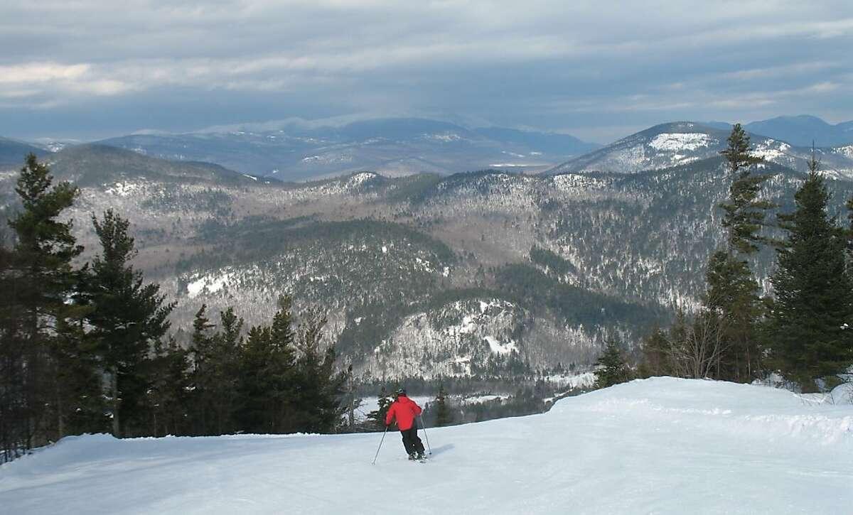 Skiing Attitash with the White Mountains as a backdrop.